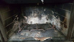 Dirty fireplace before repair