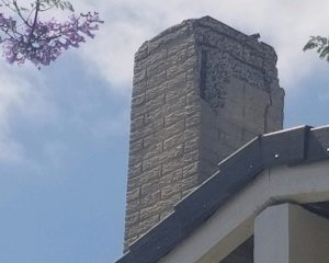 Cracked chimney falling apart